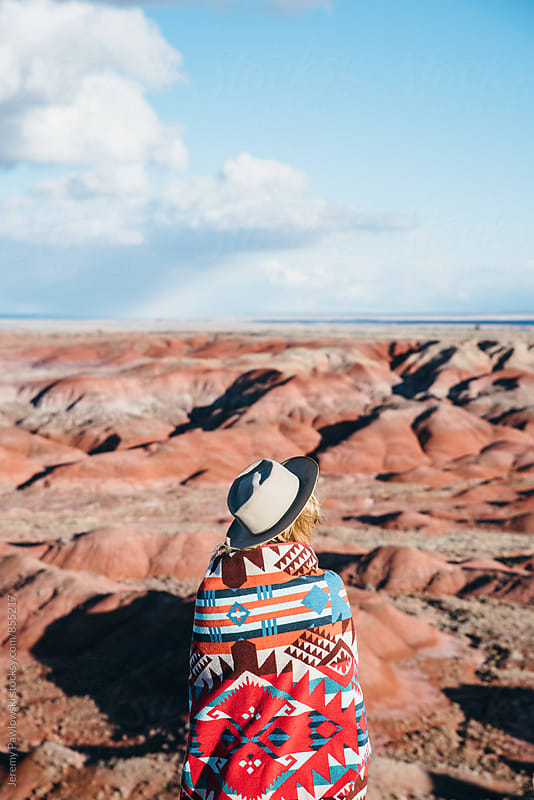 Girl wrapped in blanket looking at Painted Desert, Arizona by Jeremy Pawlowski for Stocksy United