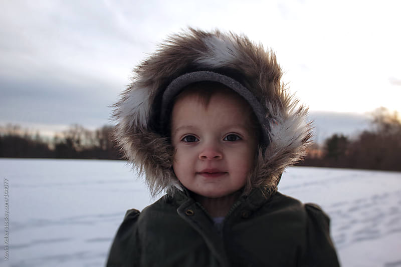 Portrait of a Toddler Girl Outside During Winter by Kevin Keller for Stocksy United