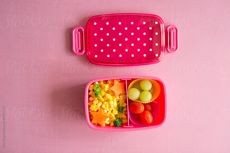 Child's healthy snacks in lunchbox by Alita Ong for Stocksy United