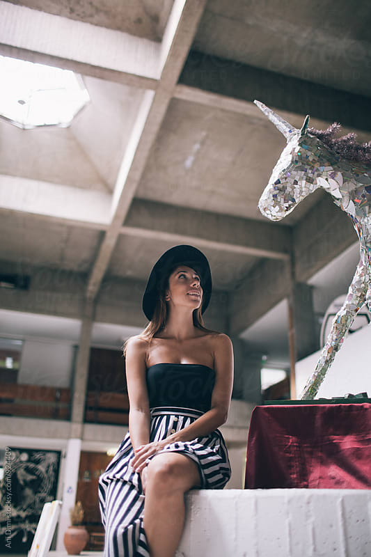 Woman looking at unicorn  by Ani Dimi for Stocksy United