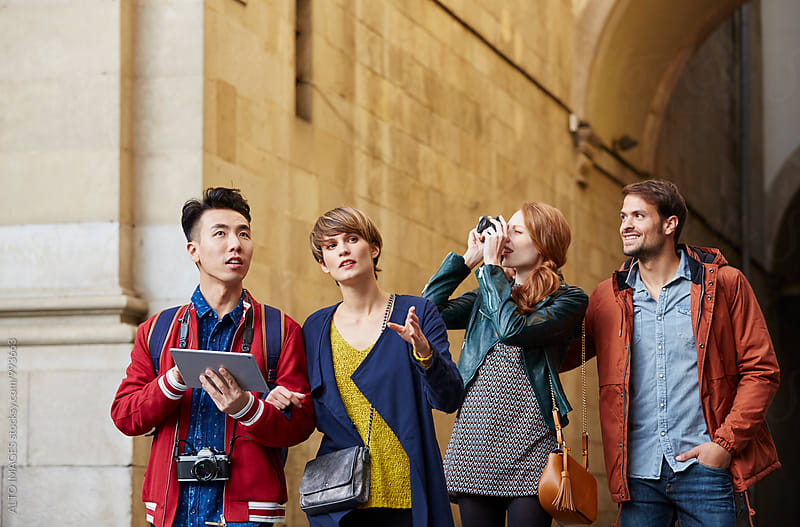 Friends With Technologies Walking In City by ALTO IMAGES for Stocksy United