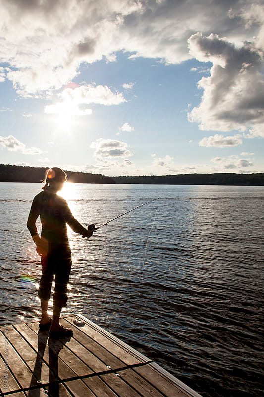 Woman Fishing from Dock at Lake by JP Danko for Stocksy United