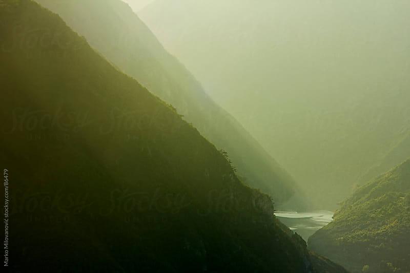 Misty river in mountain by Marko Milovanović for Stocksy United
