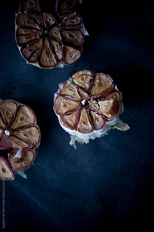 Roasted garlic by Sophia van den Hoek for Stocksy United