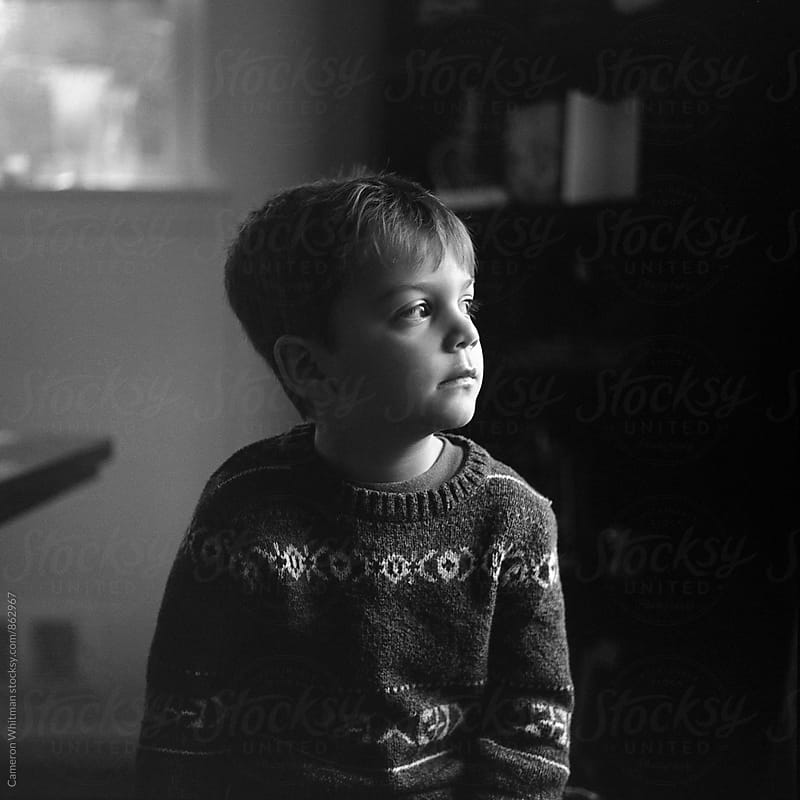 Pensive boy portrait by Cameron Whitman for Stocksy United