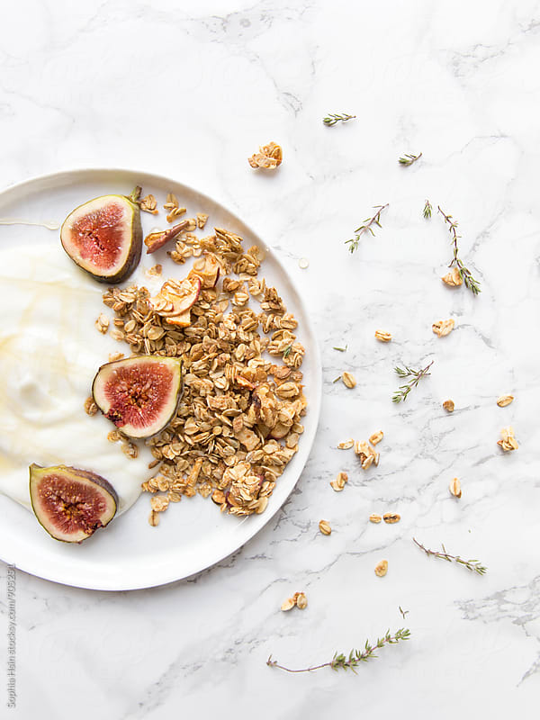 Figs and granola with yogurt by Sophia Hsin for Stocksy United