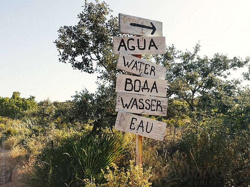 Water sign in different languages  by Luca Pierro for Stocksy United