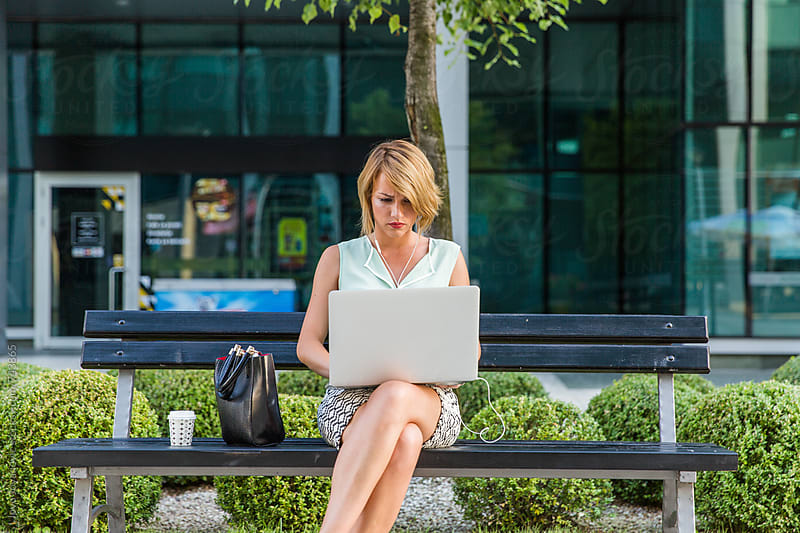 Businesswoman working outdoors by Jovo Jovanovic for Stocksy United