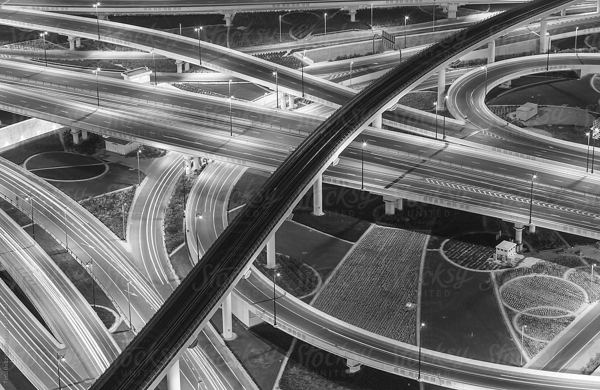 Aerial black and white photo of a dubai highway interchange at night