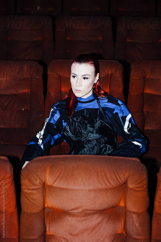Portrait of a Model Sitting in the Cinema by Katarina Radovic for Stocksy United