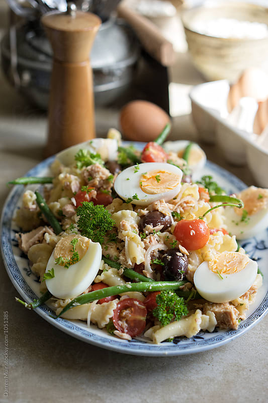 Tuna nicoise pasta salad. Platter of Nicoise salad. by Darren Muir for Stocksy United