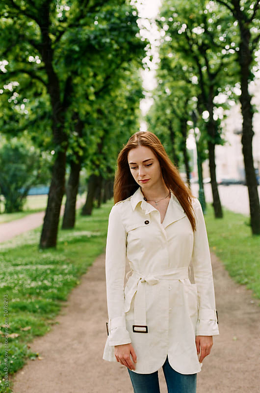 Portrait of a woman outdoors by Liubov Burakova for Stocksy United