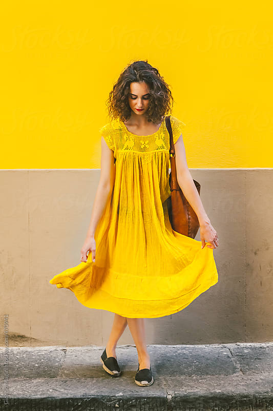 Young Woman with Vintage Yellow Dress against an Old Plaster Wall by Giorgio Magini for Stocksy United