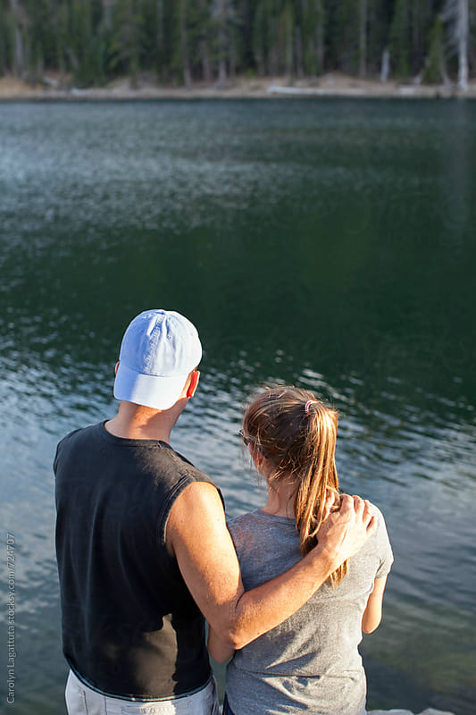 Father and teenage daughter fishing by the lake by Carolyn Lagattuta for Stocksy United