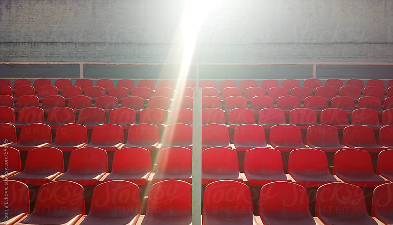 empty red stadium seats by Sonja Lekovic for Stocksy United