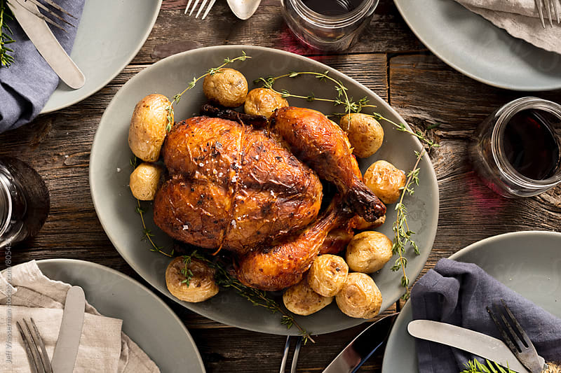 Rustic Roasted Chicken Dinner From Above by Jeff Wasserman for Stocksy United
