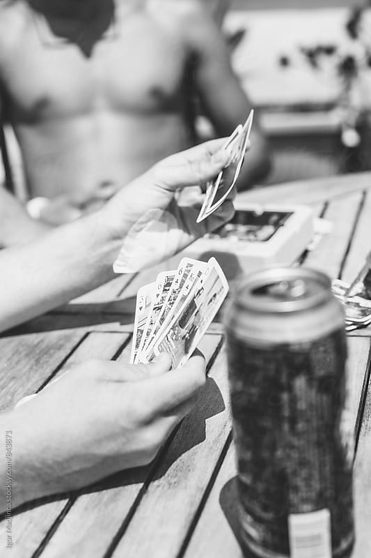 card games, entertainment, beer, fun,summer by Igor Madjinca for Stocksy United