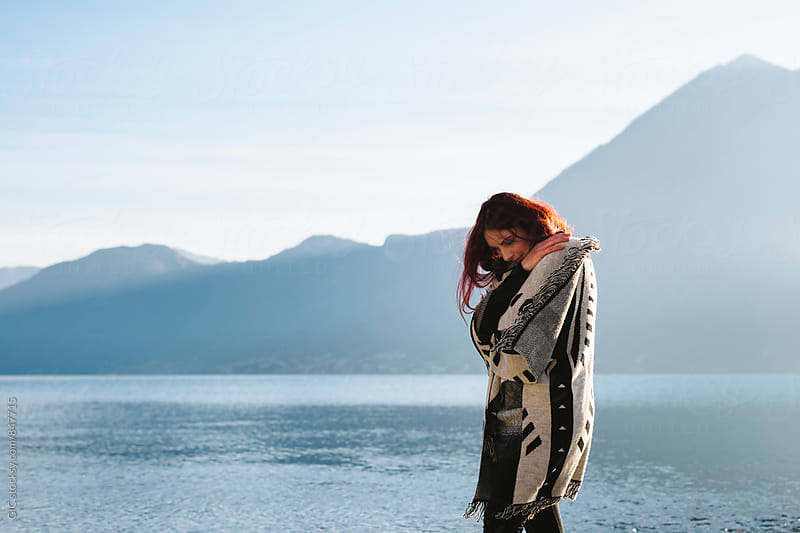 Beautiful woman outdoors across the lake by Simone Becchetti for Stocksy United