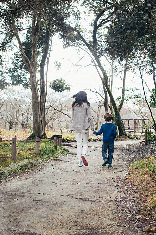 Mother and Son Walking on Forest Path by Julien L. Balmer for Stocksy United
