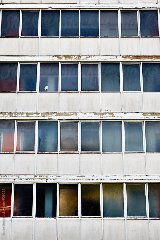 Windows of a tower block by James Ross for Stocksy United