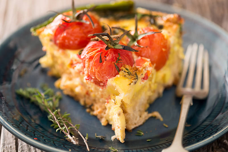 Slice of Frittata with Vine Tomatoes and Asparagus by Jeff Wasserman for Stocksy United