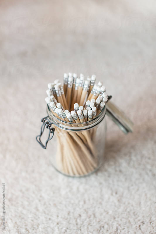 Pencils in a jar on the floor by Jonas Räfling for Stocksy United