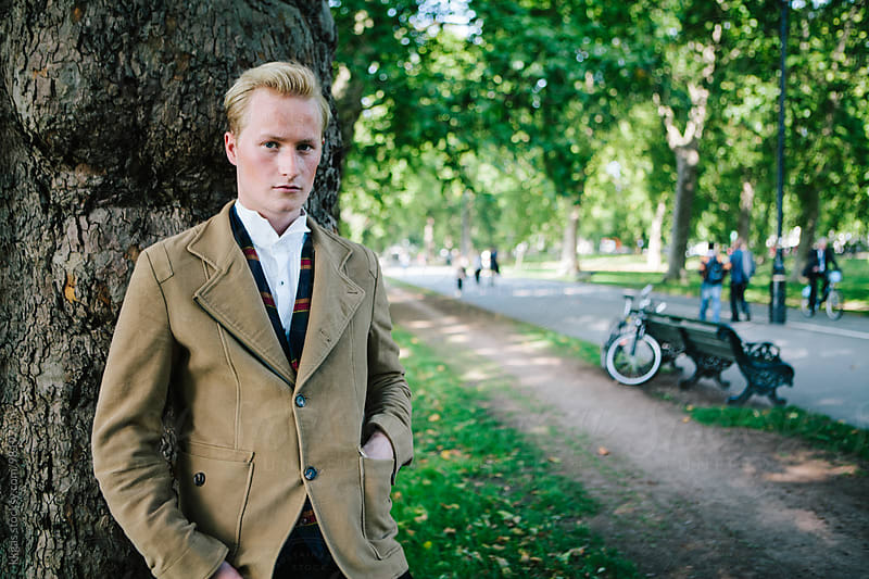 Portrait of an elegant young man outdoors by kkgas for Stocksy United