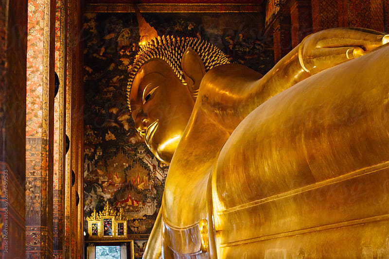 Golden Buddha in temple  by Jesse Morrow for Stocksy United