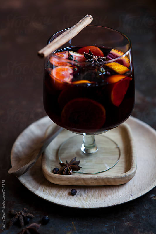 Mulled spices, cinnamon, juniper berries, star anise, orange, naartjie infused red wine by Nadine Greeff for Stocksy United
