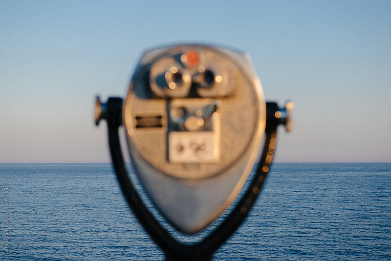 Tower viewer out of focus, looking out over the ocean by Cara Slifka for Stocksy United