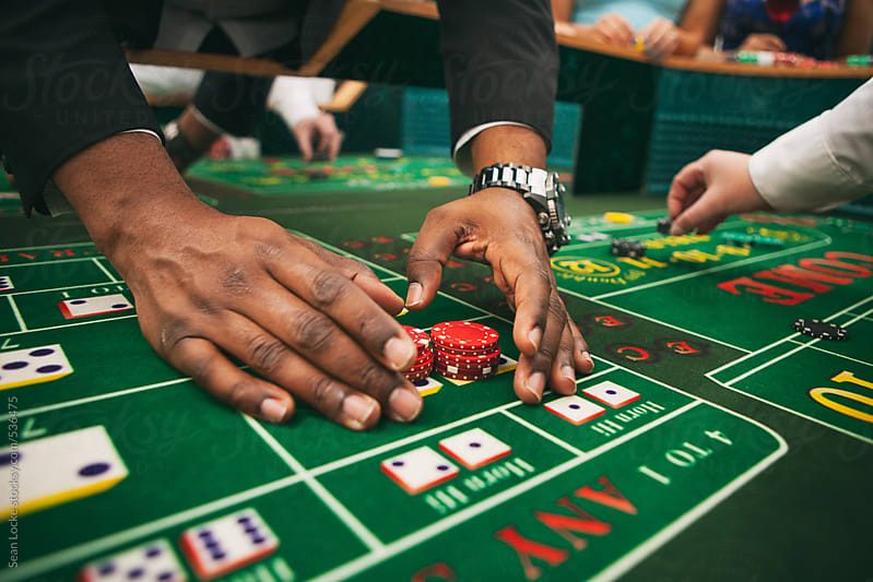 Casino: Man Wins On Craps Table by Sean Locke for Stocksy United