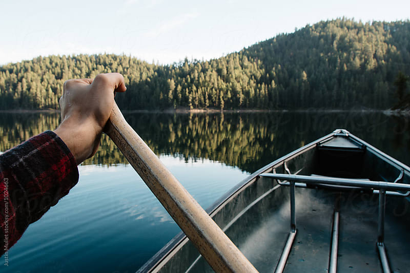 Paddling a canoe by Justin Mullet for Stocksy United