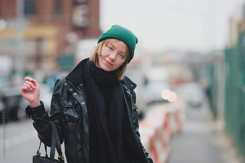 Young woman in the city  by Lauren Naefe for Stocksy United