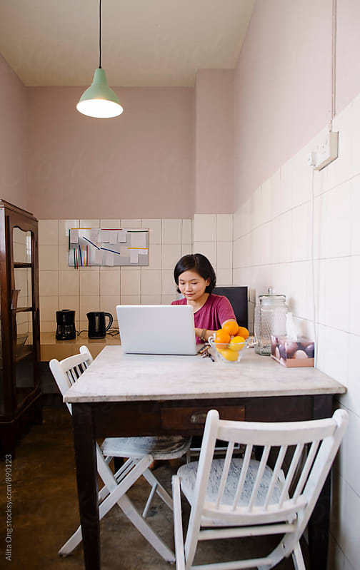 Homemaker working in a kitchen by Alita Ong for Stocksy United