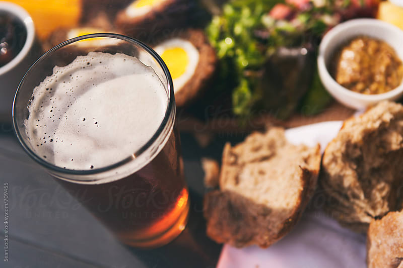 Pint Of Beer With British Ploughman's Plate by Sean Locke for Stocksy United