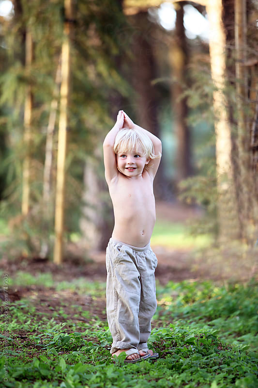 blonde boy in forrest with no shirt on by Dina Giangregorio for Stocksy United