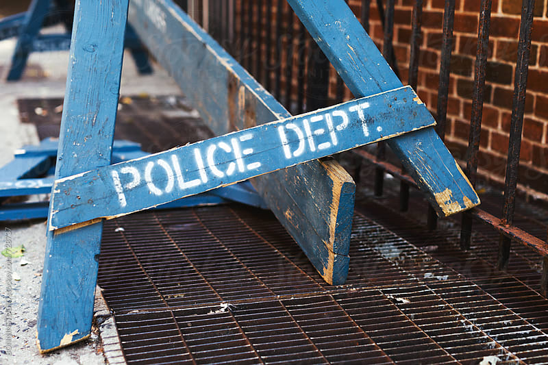Abandoned blue police fence.  by BONNINSTUDIO for Stocksy United