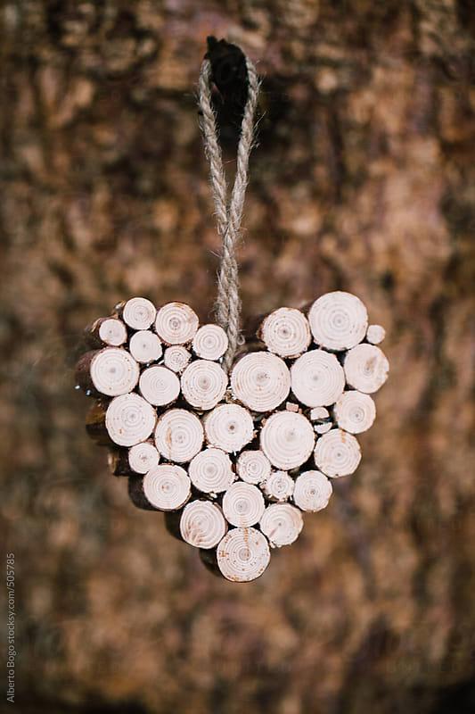 Heart shape on wood by Alberto Bogo for Stocksy United