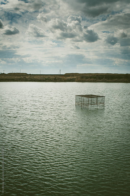 The cage in the lake for fish by Brkati Krokodil for Stocksy United