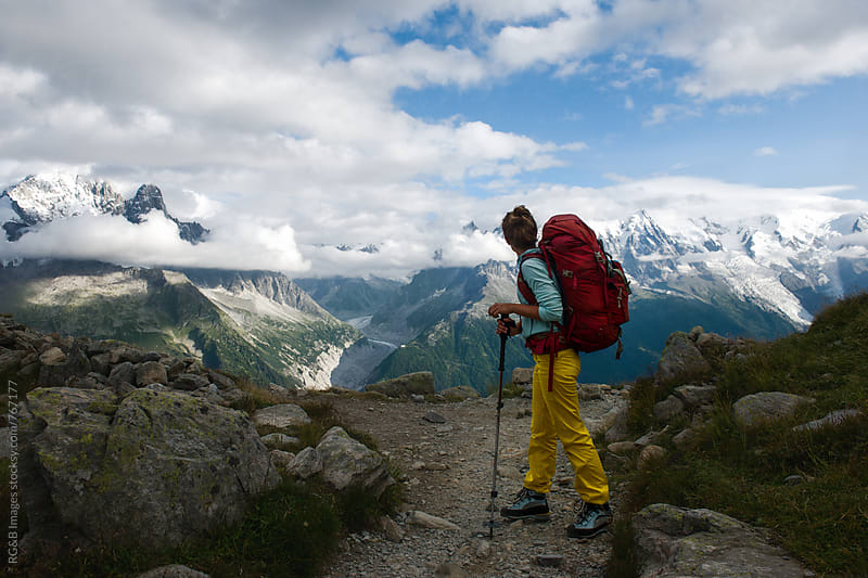 Female hiker looking at the majestic mountains by RG&B Images for Stocksy United