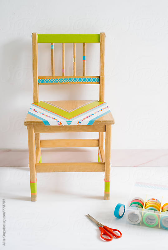 Decorating old kid's chair with washi tapes by Alita Ong for Stocksy United