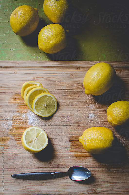 Lemons and sugar on a cutting board in the kitchen by Lindsay Crandall for Stocksy United
