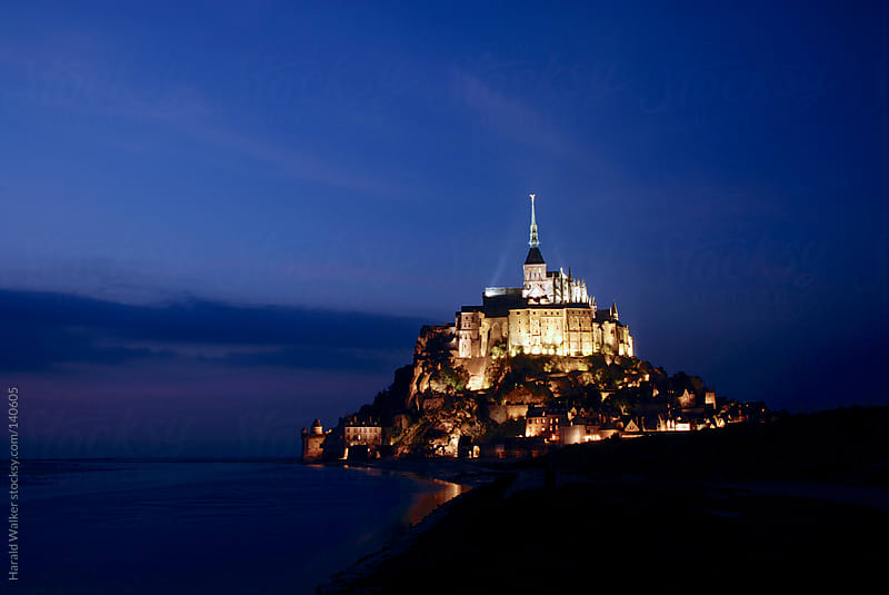 Mont Saint-Michel at night by Harald Walker for Stocksy United