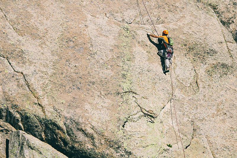Man climbing on big wall by Alejandro Moreno de Carlos for Stocksy United