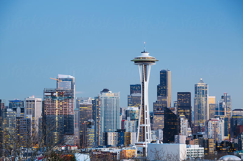 Classic view of downtown Seattle with Space Needle against blue sky by Mihael Blikshteyn for Stocksy United
