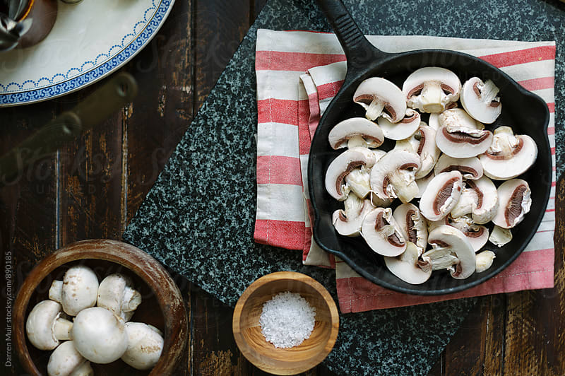 Preparing mushrooms for cooking. by Darren Muir for Stocksy United