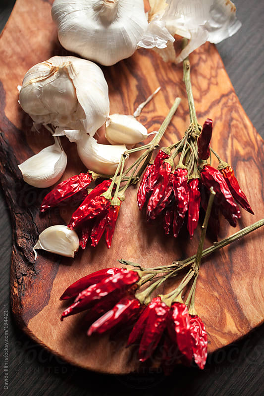 Group of garlic and hot chili pepper by Davide Illini for Stocksy United