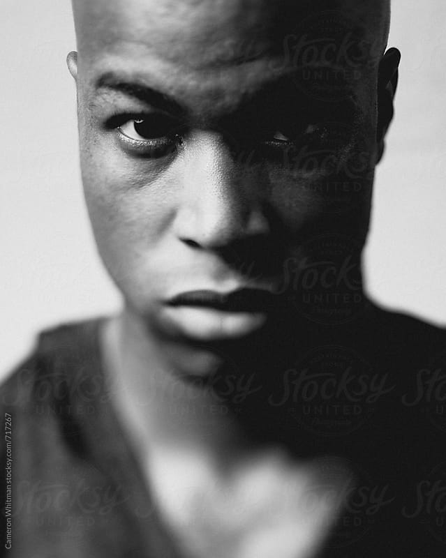 Serious expression portrait with tilt shift  by Cameron Whitman for Stocksy United