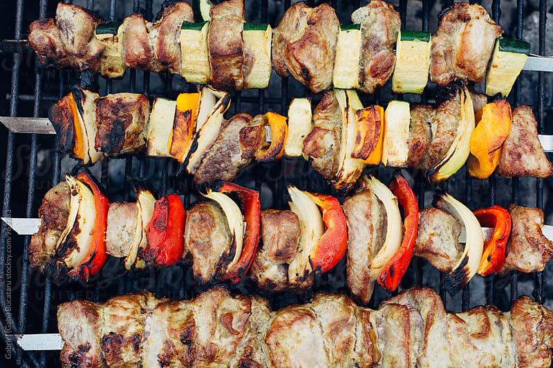 Grilled meat shish kebab on a barbeque by Gabriel (Gabi) Bucataru for Stocksy United