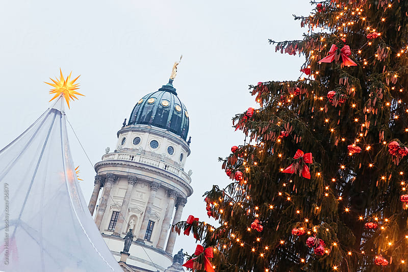 Europe, Germany, Berlin, traditional Christmas Market at Gendarmenmarkt  - illuminated at dusk by Gavin Hellier for Stocksy United